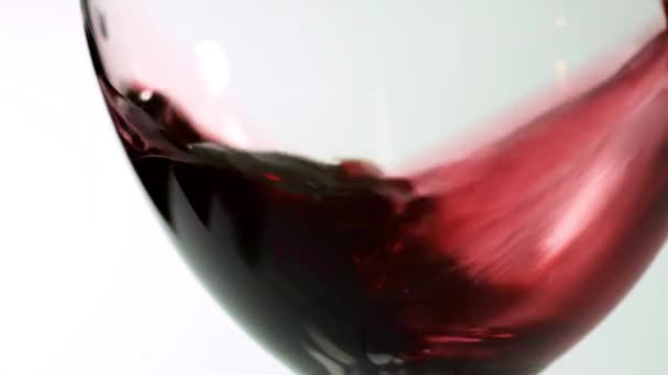 slow motion closeup of red wine poured into a glass