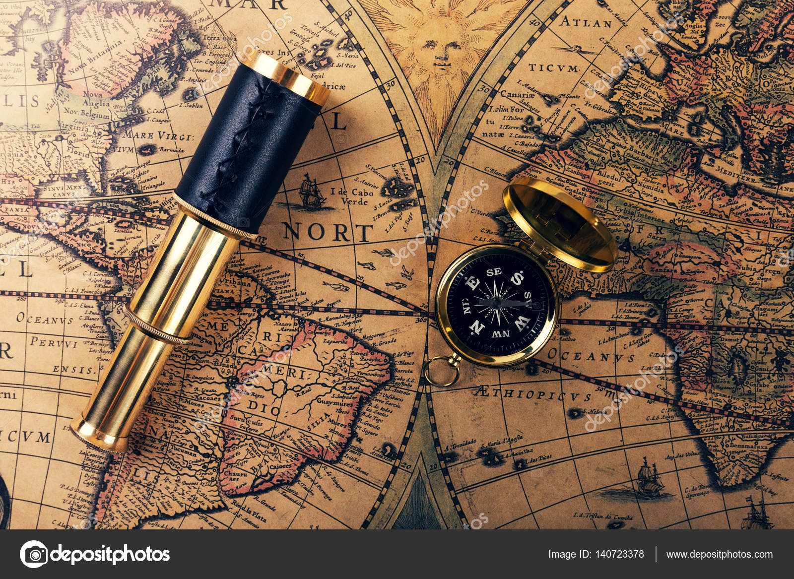 Vintage compass and spyglass on ancient world map stock photo vintage compass and spyglass on ancient world map stock photo gumiabroncs Gallery