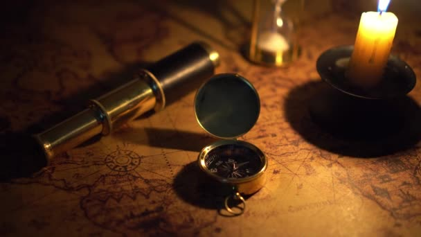 compass and spyglass on old world map in candlelight