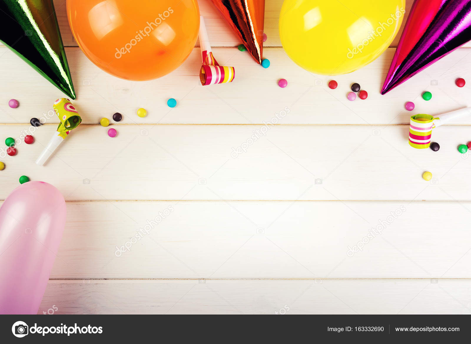 birthday party accessories with copy space on white wood background