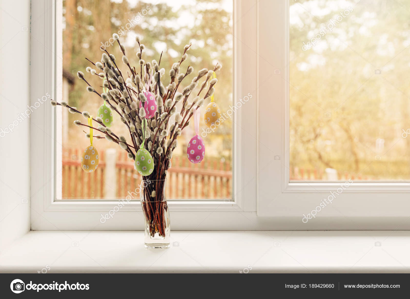 Easter Decoration Vase With Colorful Eggs Hanging In Pussy Willow