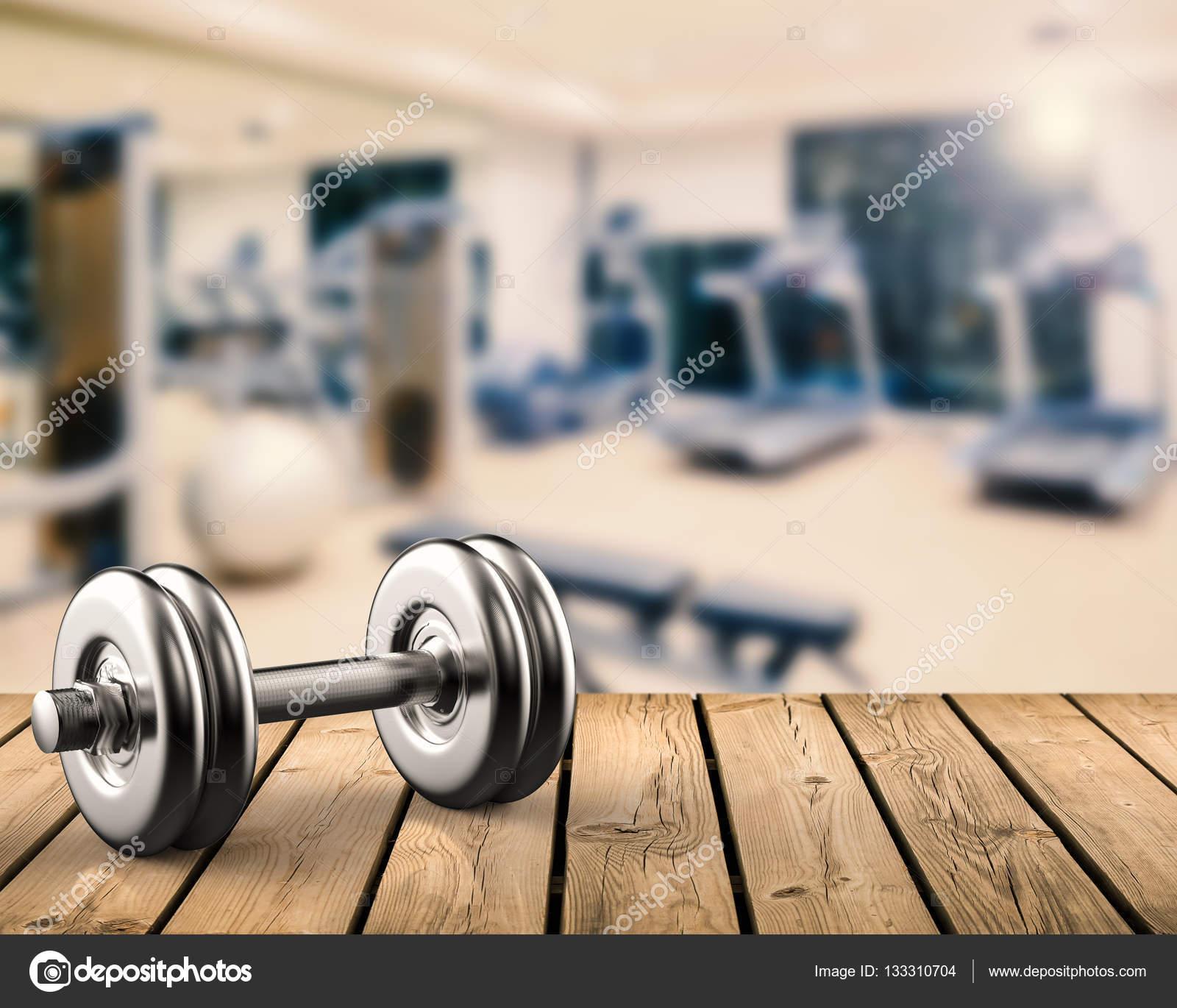 Metal dumbbell with gym background — Stock Photo © phonlamai