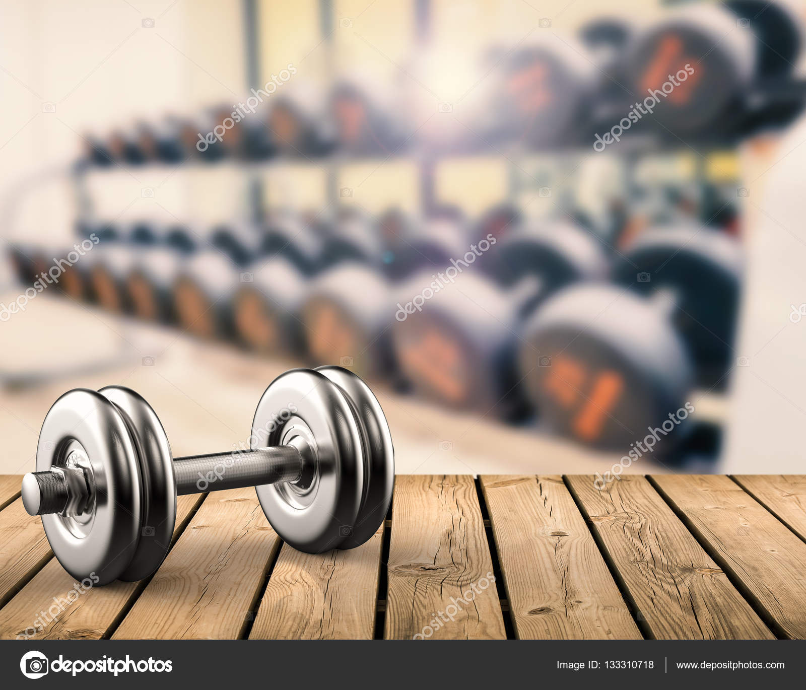 metal dumbbell with gym background � stock photo