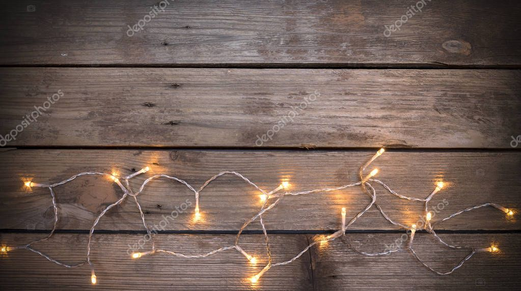Christmas led lights on wooden background