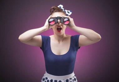 Pretty Pin Up girl loking through binoculars