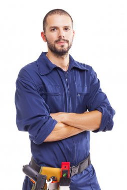 Young worker standing with arms crossed