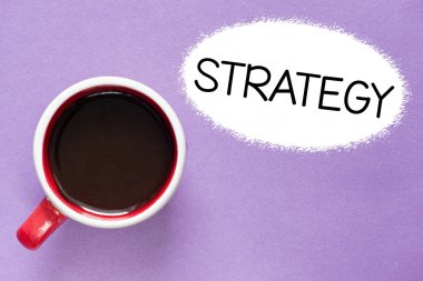 Strategy inscription by cup of coffee