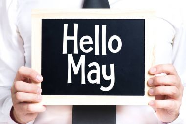 Man holding blackboard with text Hello May stock vector