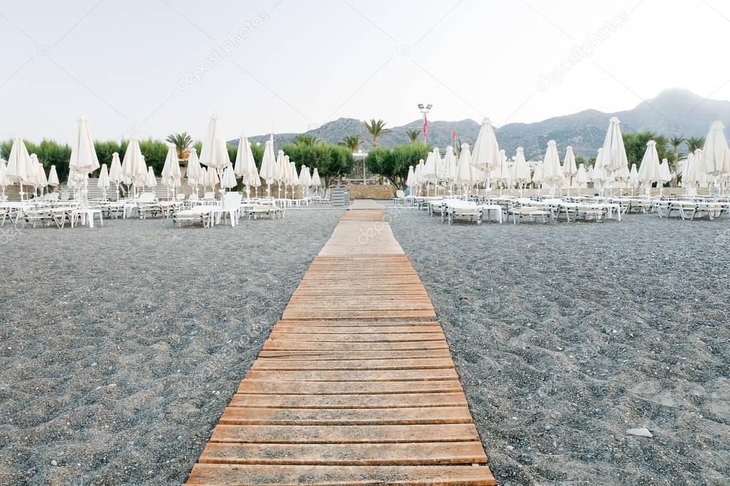 wooden path leading to sea