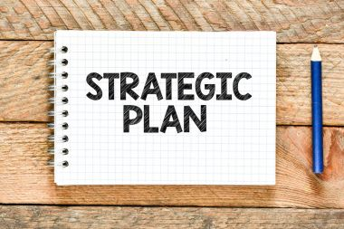 strategic plan writing on note book