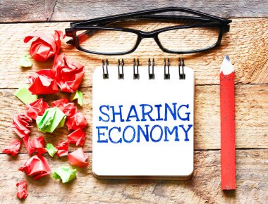 Sharing Economy on notepad, business concept