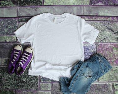 White T Shirt mockup flat lay on purple brick background with pu