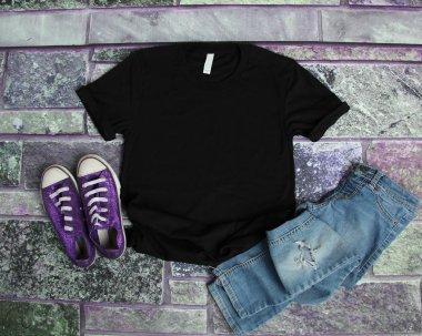 Black T Shirt mockup flat lay on purple brick background with pu