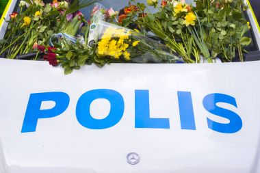 STOCKHOLM, SWEDEN - April 09, 2017: Flowers on a police van. tru