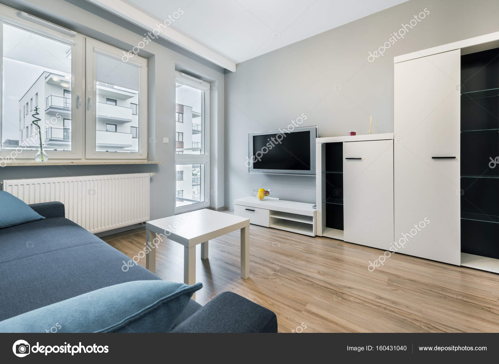 Modern Living Room With Grey Walls Stock Photo