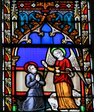 Stained Glass - Angel giving Holy Communion