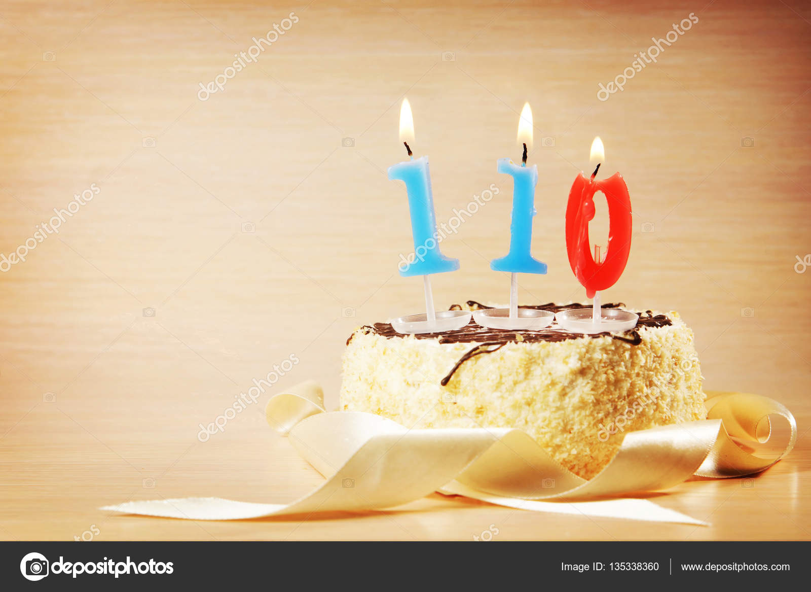 Birthday Cake With Burning Candle As A Number One Hundred And Ten