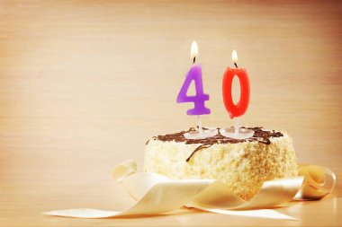 Birthday cake with burning candle as a number forty