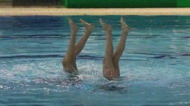 Performance of girls synchronized swimmers