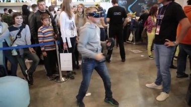 Boy uses virtual reality game development kit, virtual reality glasses