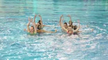Perfomance of girls synchronized swimmers