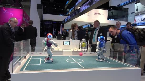 Small humanoid NAO robots playing soccer on Messe fair in Hannover, Germany