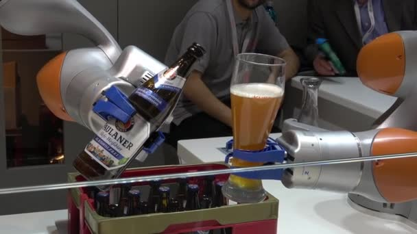 Kuka robot arms pouring beer on Messe fair in Hannover, Germany