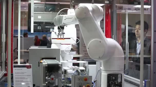 Automatic robot arms on Staubli stand on Messe fair in Hannover, Germany
