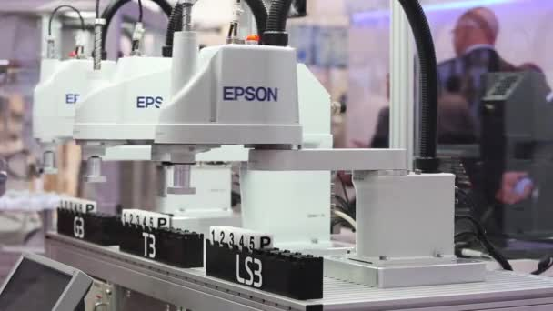 Automation solutions with Epson robot arm in assembly line on Epson stand on Messe fair in Hannover, Germany