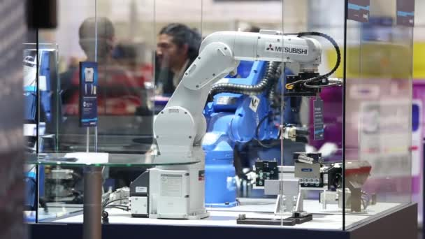 Mitsubishi and Yaskawa robot arms on Schunk stand on Messe fair in Hannover, Germany