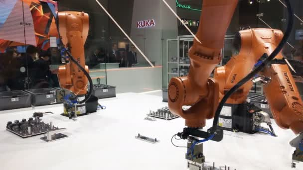 Automation solutions of the future with robot arms on Kuka stand on Messe fair in Hannover, Germany