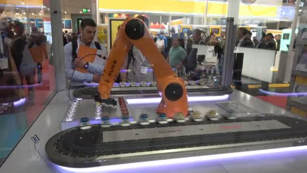 Automation solutions with Kuka robot arm and Ethercat on Beckhoff stand on Messe fair in Hannover, Germany