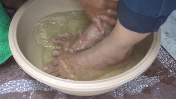 Foot massage in water.