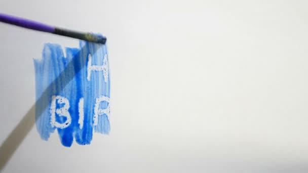 Boldog születésnapot szöveg felirat akvarell művész festékek blot elszigetelt fehér háttér művészet videó