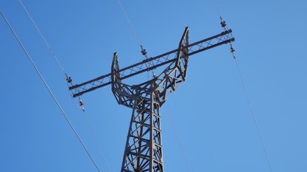 high-voltage tower against a blue sky Electricity technology wires