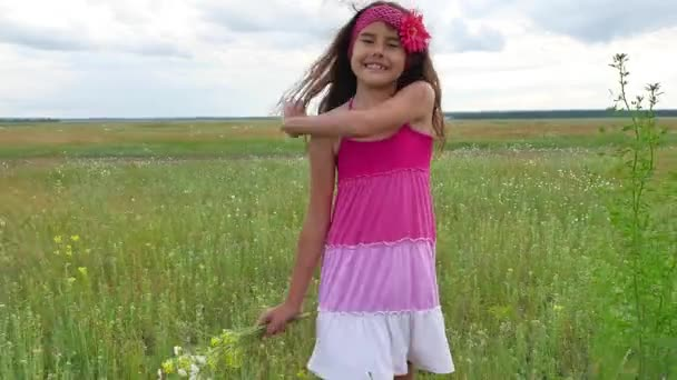 Girl teenager with flowers goes to field nature. Summer field with wild flowers lifestyle