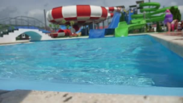 aquapark. water park people ride from the slides and jump into the pool
