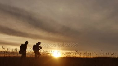 people go group travel of tourists field nature of a sunset silhouette two travel people . tourists nature lifestyle people group go