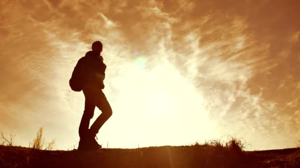 Silhouette of tourist traveler man hiker. Man With Backpack ,man silhouette at the sunset outdoors lifestyle , man is standing nature concept