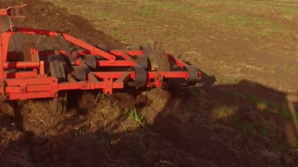 Farmer in tractor plows Russia steadicam motion agriculture soil the ground preparing land with seedbed cultivator as part of pre seeding activities in early spring season of agricultural works at