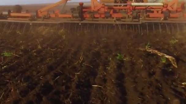 Farmer in tractor plows Russia steadicam motion agriculture soil the ground preparing land with seedbed cultivator as lifestyle part of pre seeding activities in early spring season of agricultural