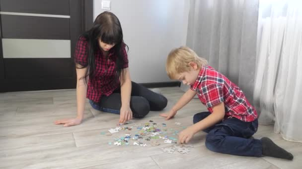 happy family collection puzzles teamwork. development of fine motor skills and thinking. little boy a and girl mom lifestyle collect mosaic puzzles