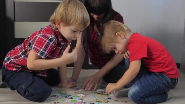 happy family collection puzzles teamwork lifestyle . development of fine motor skills and thinking. little boy and girl with mom a collect mosaic puzzles