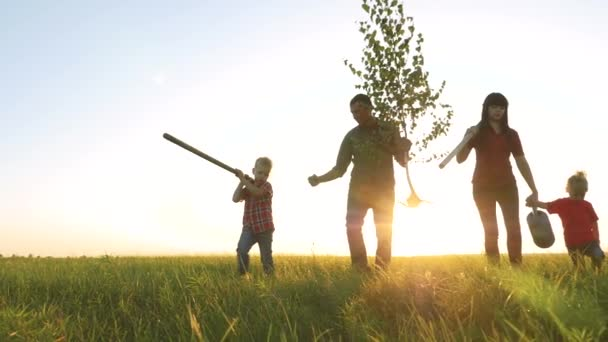 agriculture red neck farming happy family walking agriculture of farmers a silhouette concept slow motion video. mom dad son and lifestyle daughter walk go children happy family plant and water the