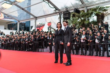 CANNES, FRANCE - MAY 9, 2018: Director A.B. Shawky and producer Elisabeth Shawky-Arneitz attend the screening of 'Yomeddine' during the 71st annual Cannes Film Festival