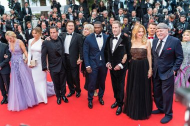 CANNES, FRANCE - MAY 15,  2018: Kevin Connolly with 'Gotti' cast, John Gotti Jr, 50 Cent, John Travolta and Kelly Preston attend the red carpet screening of 'Solo: A Star Wars Story' during the 71st annual Cannes Film Festival