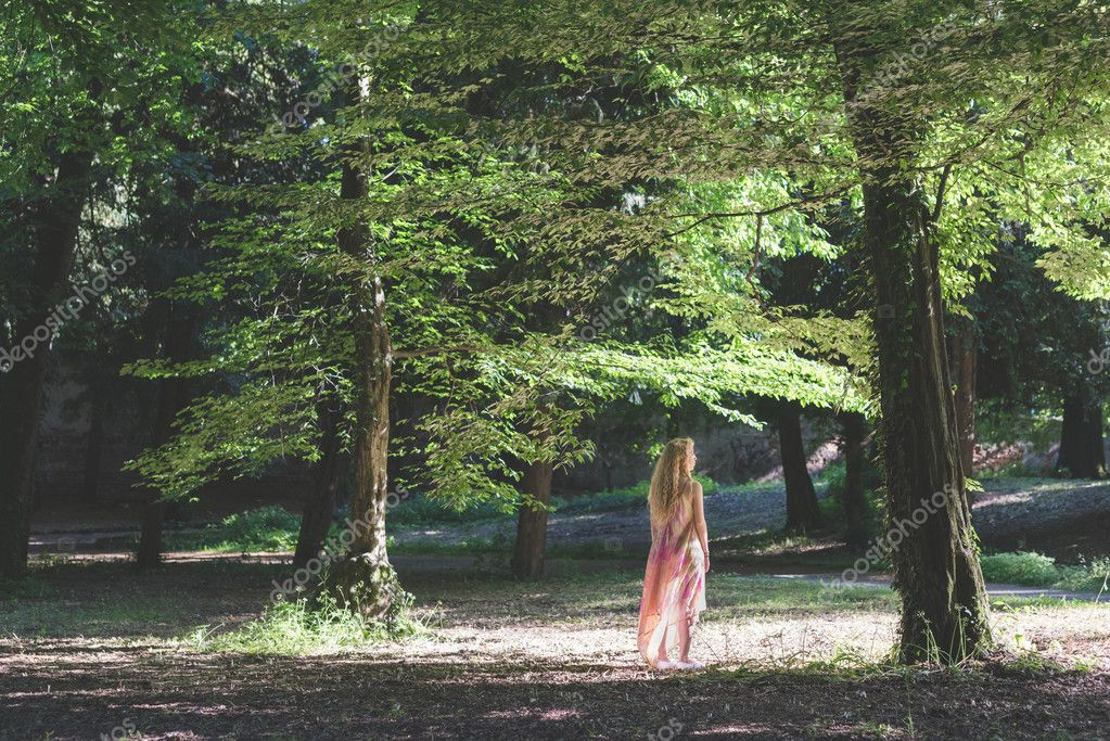 woman wearing pink dress in forest