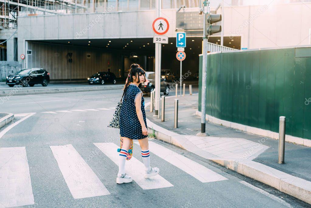 asian woman skater walking