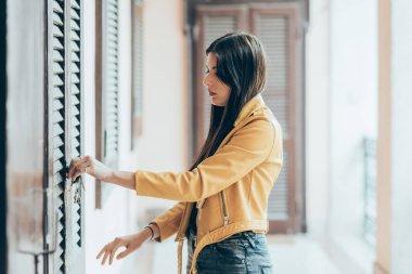 woman opening or closing front door