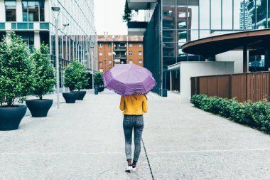woman walking outdoor in rainy day